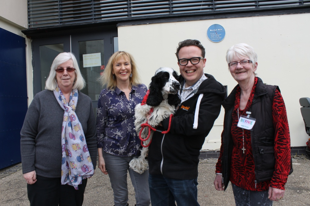 Left to right: Maureen Cole – long-term volunteer; Sue Jones – Centre Manager; Matt Caldwell – KWCC Deputy Head; Jake – Therapy dog and Bernie Henning – Meet and Greet Volunteer.