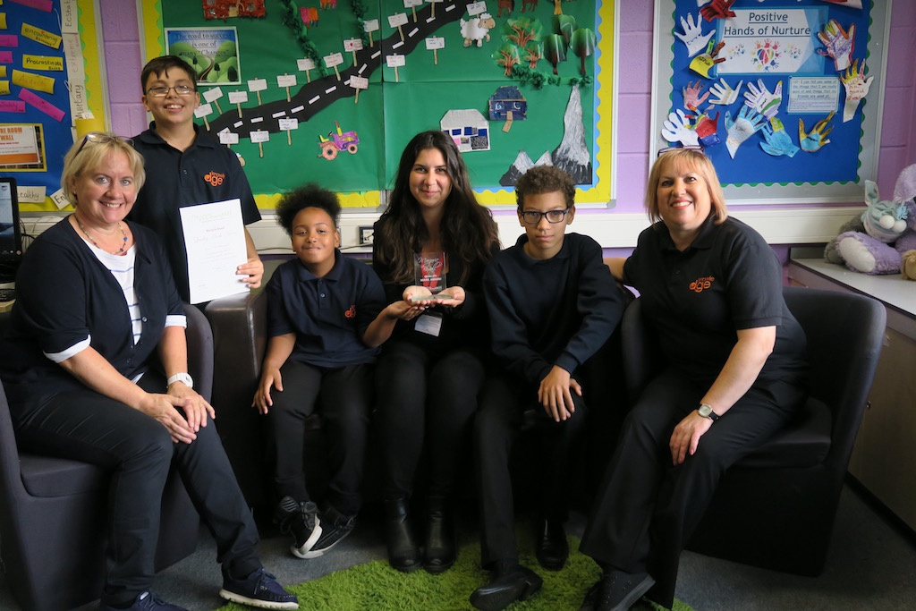 Staff and pupils at Knowle DGE Learning Centre with their award.