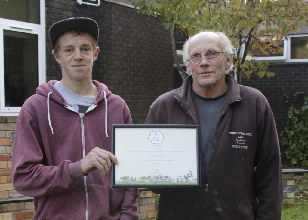 Left to right Lewis Prince and Andy Moseley at Andy's Haven with their Outstanding award from South West in Bloom.