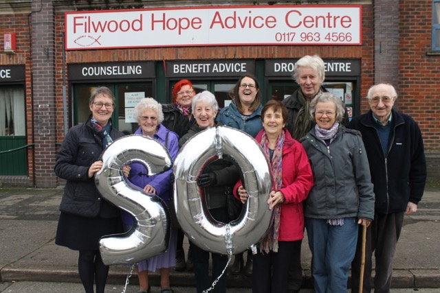 Staff and volunteers celebrating at Filwood Hope: Front row L-R Centre Manager Pearl Atiken, Margaret Nash, Margaret Cribb, Lorna Payne, and Marion Grove. Back row L-R Lisa Herbert, Advisor Laura Hathway, Dave Harris and Graham Blacker