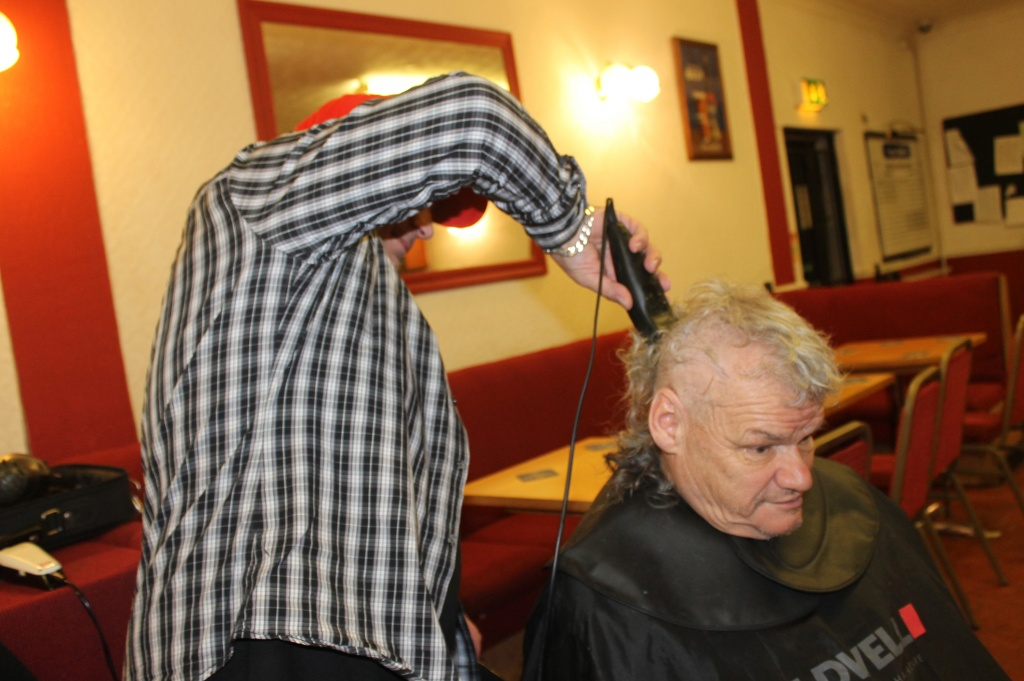 Dave Marsh takes part in the sponsored headshave at the hands of hairdresser Wayne Rundell.