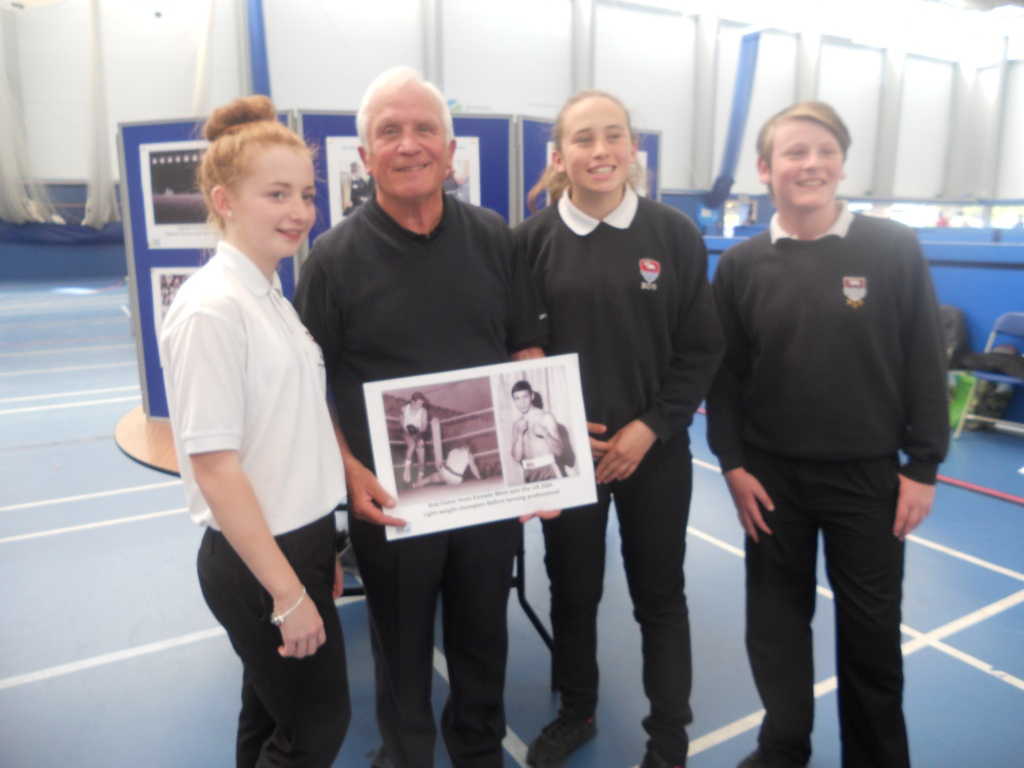 Former boxer Bob Fisher from Knowle with Bedminster Down pupils at City Academy.