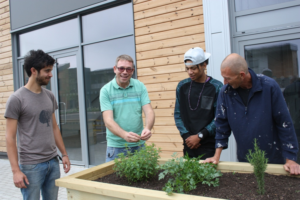 Staff at the Pop up Furniture Factory at Filwood Green Business Park are shown the new edible planters by gardener Steve Griffiths (right)