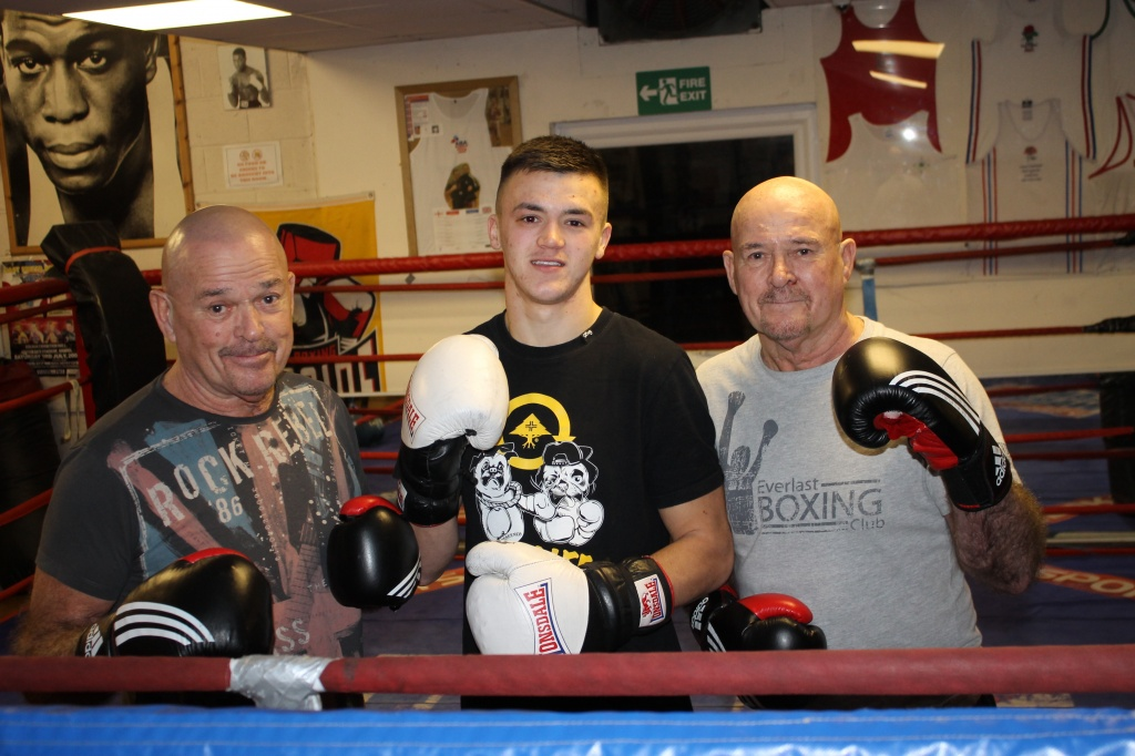 Former UK boxing champions twins Michael Davis left, and Brian Davis with Mickey Parsons (centre) Brian's grandson representing the Community Police Clubs of Great Britain.