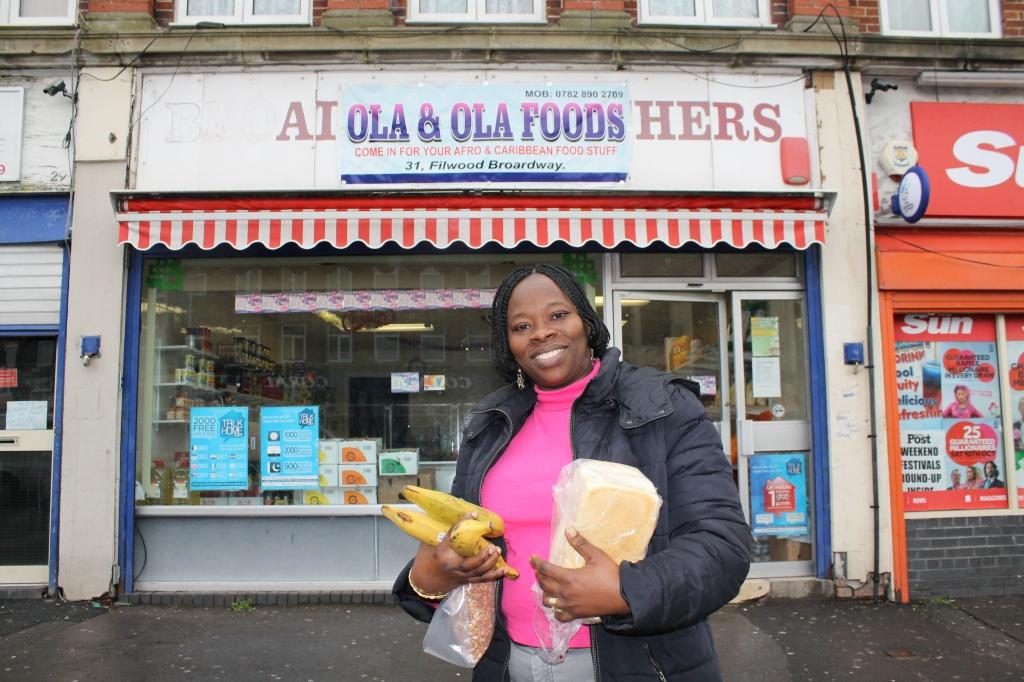 Adeola outside Ola and Ola Foods