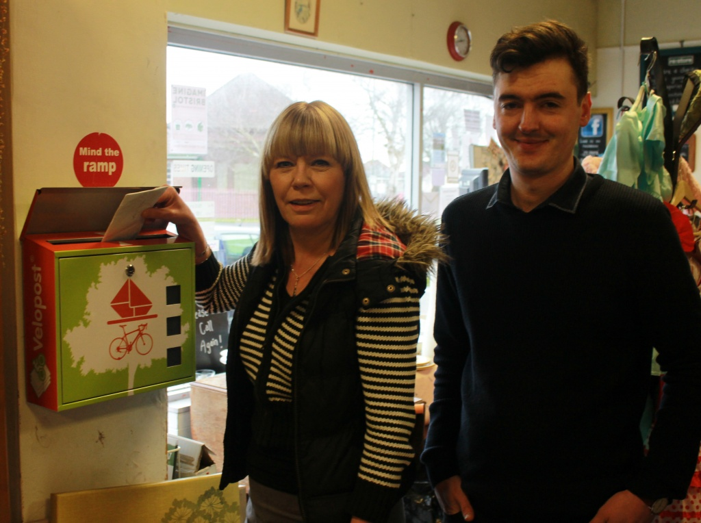 L to r: re:work Office Manager Jane Smallcombe with Velopost Senior Sales Executive Jeremy Field using the Velopost box at re:store
