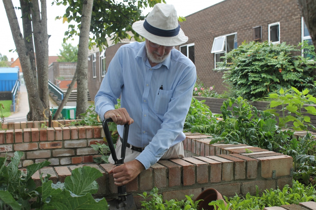 Filwood Chase History Society member Jim Smith working on the Dig for Victory garden at The Park.
