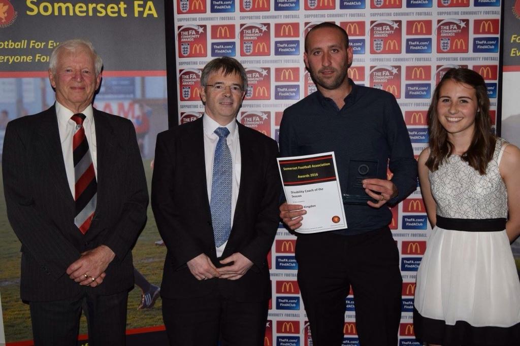 Daniel Kingdon centre receiving his award from the Somerset FA