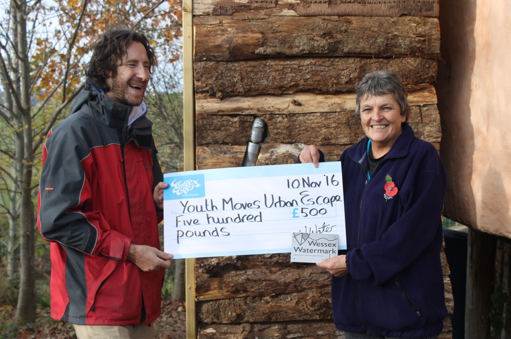 Youth Worker Ben Carpenter receives a cheque for £500 for the Urban Escape Project at Springfield Allotments from Wessex Water's Educational Officer Sue Goodland.