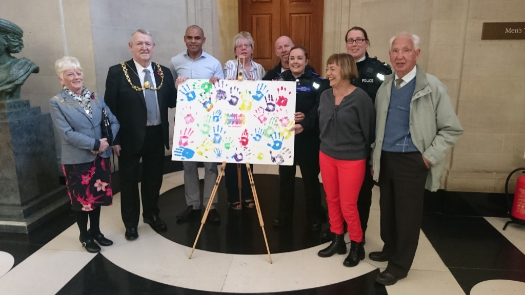 L to r: Lady Mayoress Bridget Lovell, Lord Mayor Cllr Jeff Lovell, Bristol Mayor Marvin Rees, Chair of Knowle West Health Association Board, Carol Casey, Flwood councillor Chris Jackson, PCSO Katie Allwood-Coppin.Sgt Alecto Shyne, Deputy Mayor of Bristol Cllr Estella Tincknell and Filwood resident Ken Jones with the art work at City Hall.
