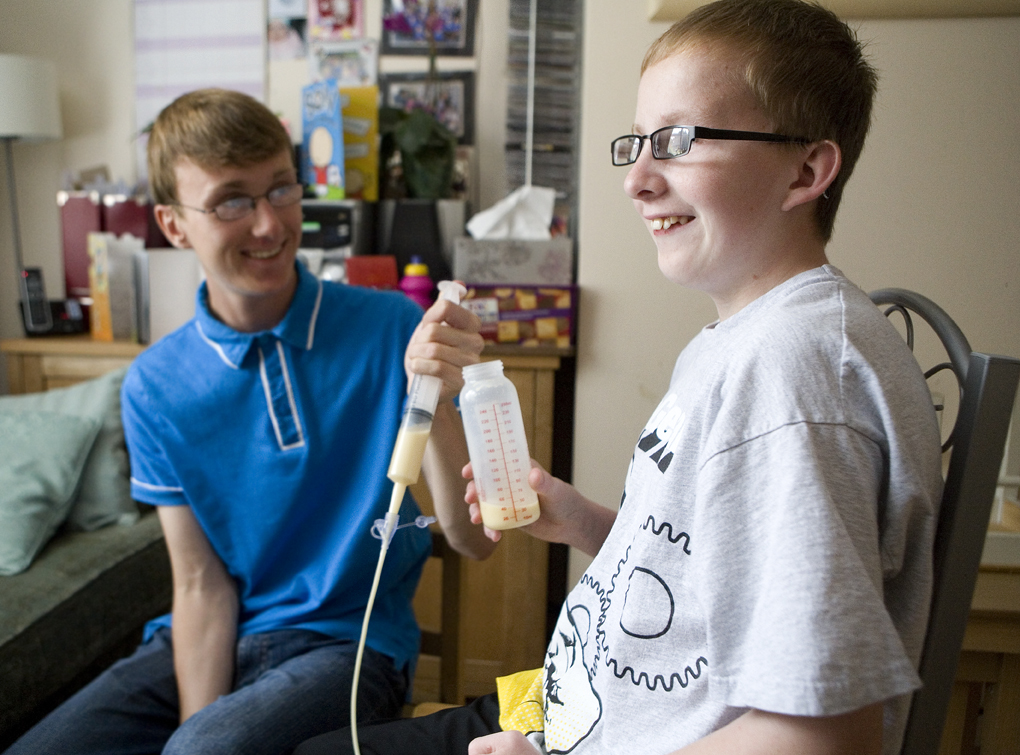 A young carer looking after his brother. Picture © Carers Trust.